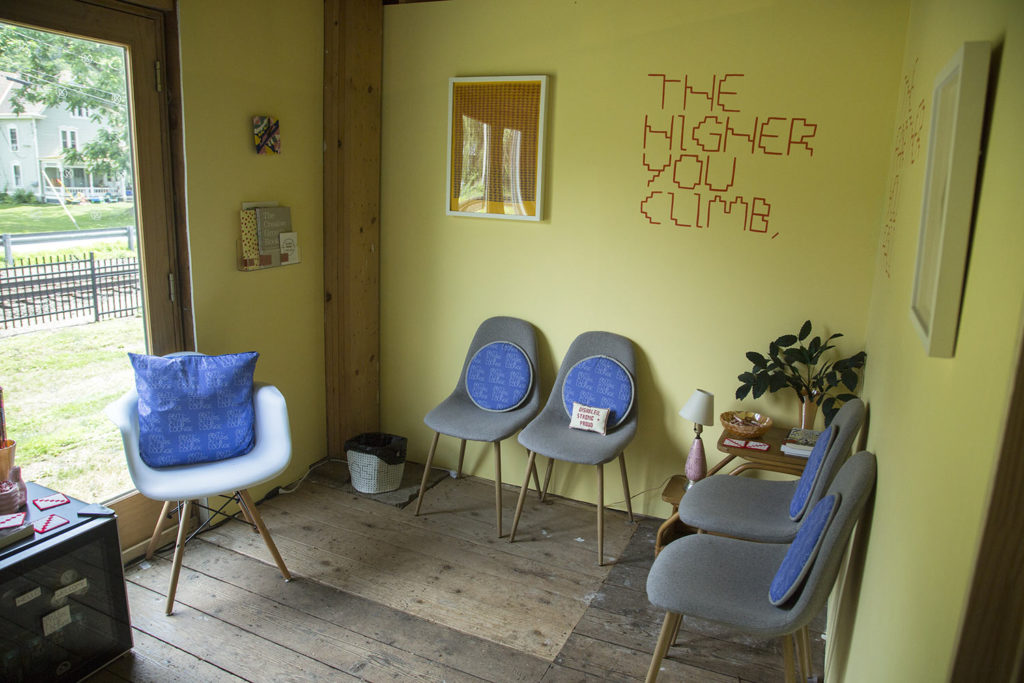 the higher you climb written on one of the lounge walls