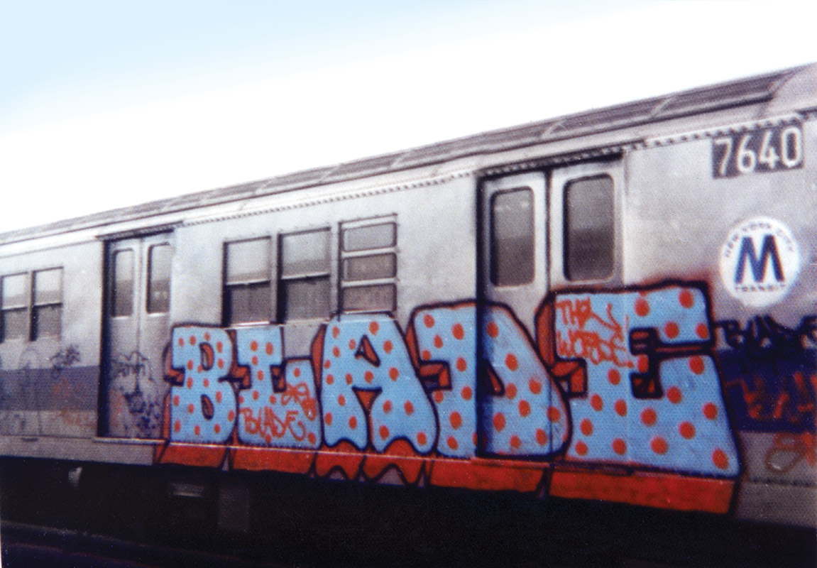 BLADE spray painted on the side of a subway car