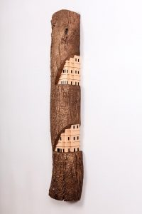 A city carved into a piece of wood
