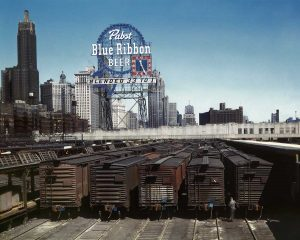 Railroad yard with Pabst Blue Ribbon sign in the background
