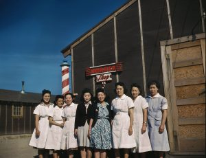 A group of Japanese women in front of a barbershop