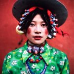 A Tibetan woman wearing bold makeup and jewlery