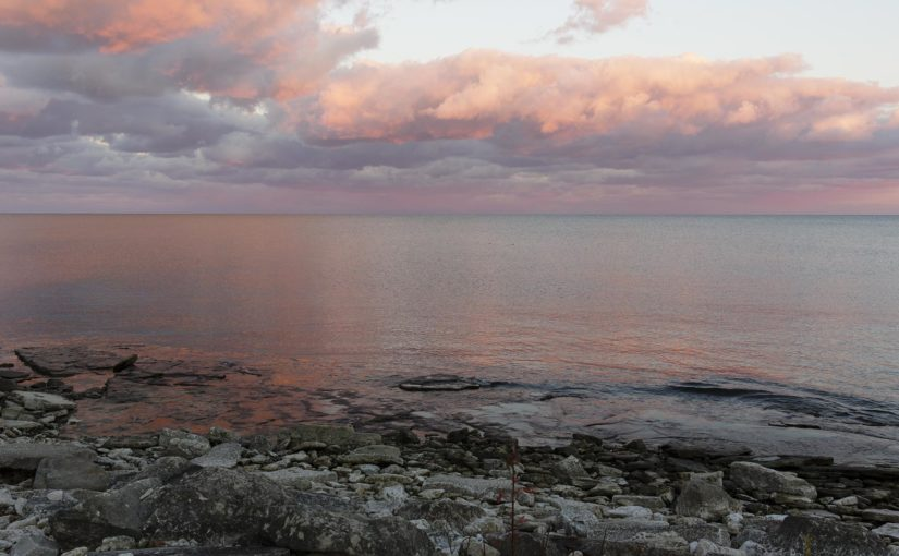 view of the sky from the rockey shore of lake erie