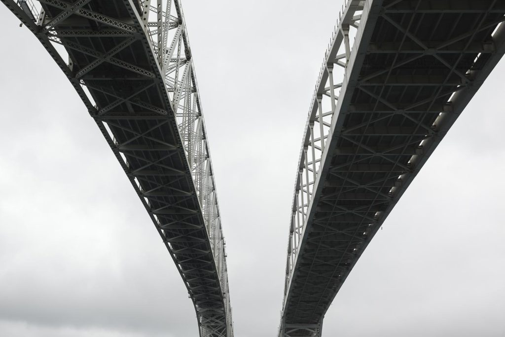 a bridge stretches across the sky above