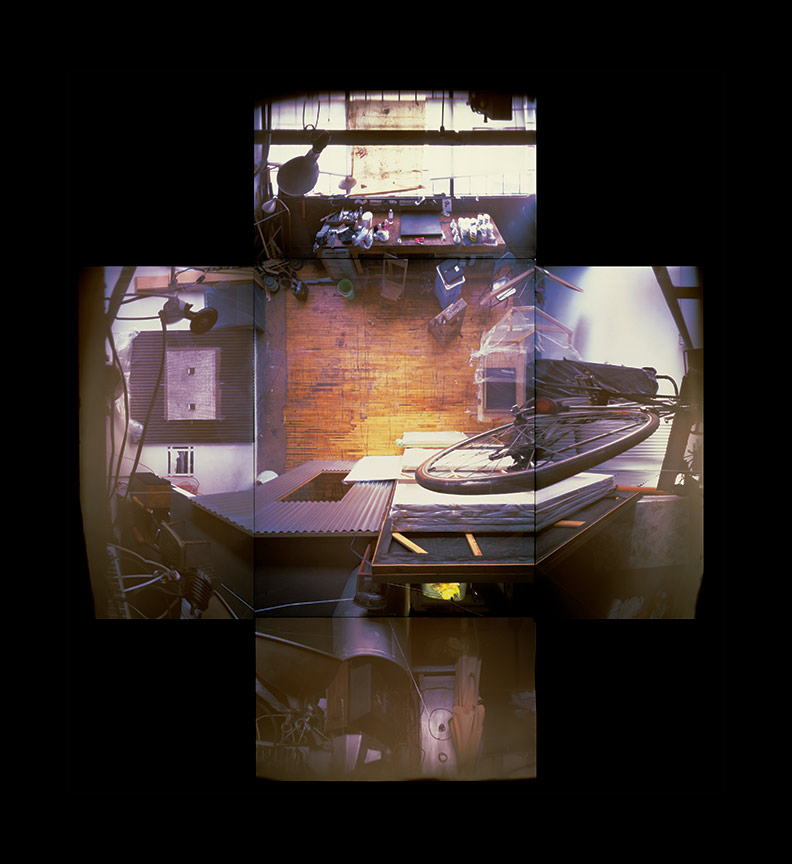 """These four images are part of a series documenting workspaces in a former munitions plant. These spaces were cheap to rent and easily adaptable. Each photo illustrates a space in which everyday life and creative practice are organically integrated. Evicted May 1, 2000 (9 Hanna Ave.), 13 colour pinhole photos, 20x24"""" and 24"""" x 30"""", 2001, photos: Adrian Blackwell. Photo 1 — Gordon Anderson's Space."""