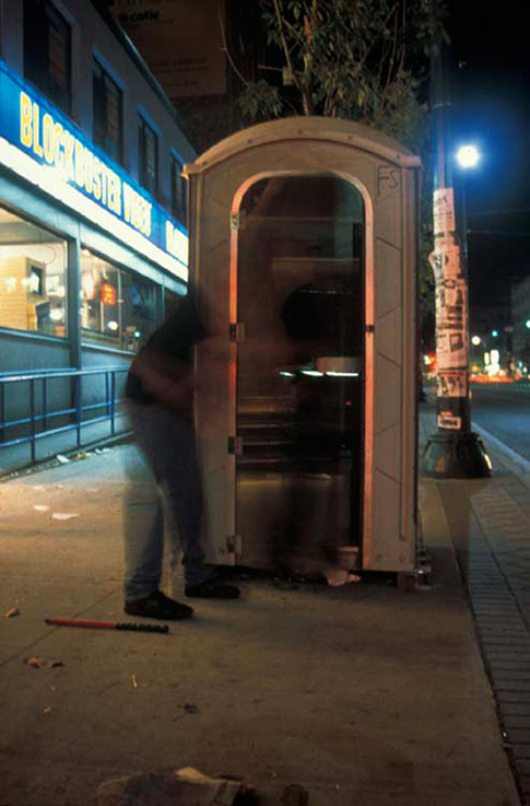 Public Water Closet, modified portable toilet, 2-way mirror glass (Ottawa and Toronto), 1998, photos: Adrian Blackwell.