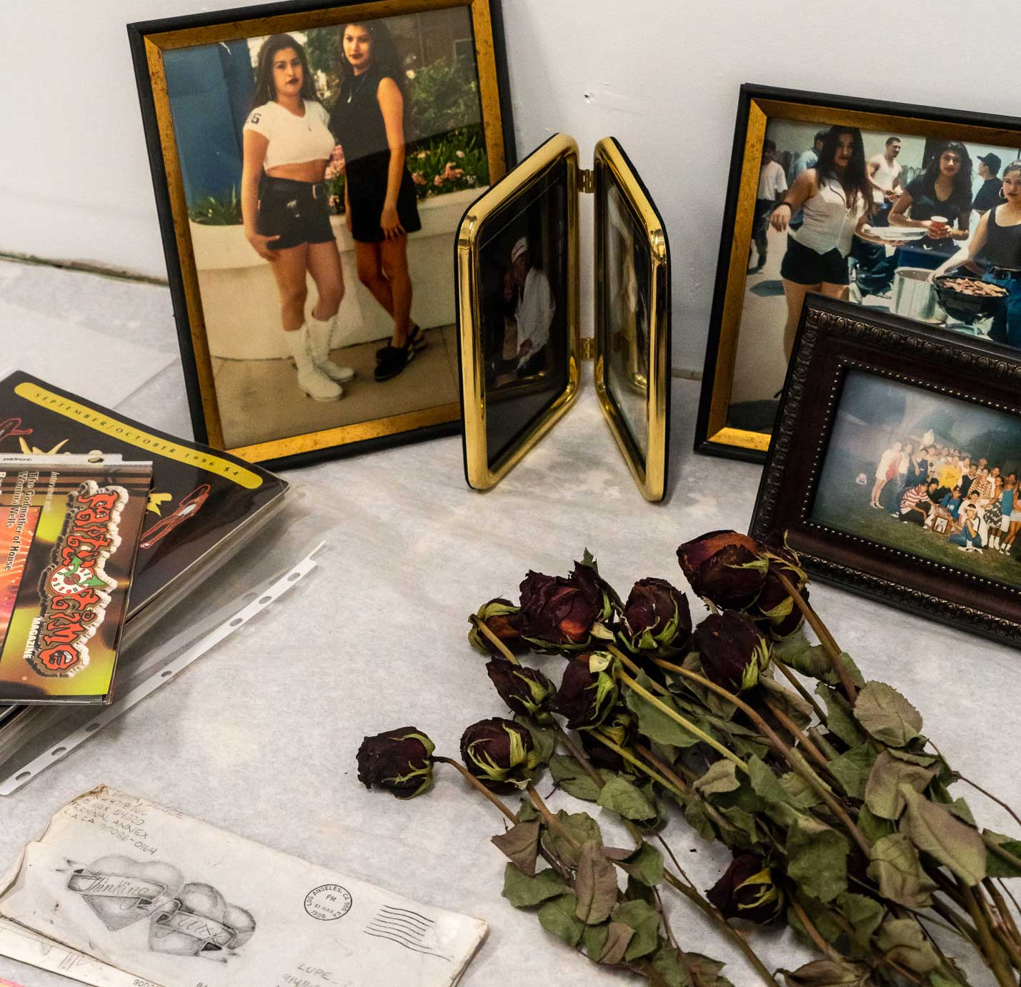 Photos, flowers, and letters forming a shrine