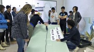 Students begin the process by splitting the polystyrene board into more manageable pieces.  Photo by John Muse.