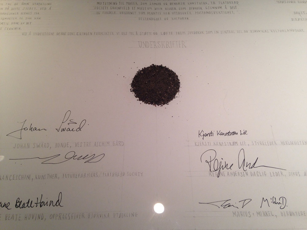 A Norwegian land use document with a spot of soil at the center