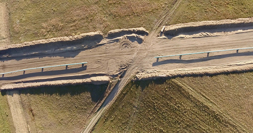 Overhead view of dirt roads converging