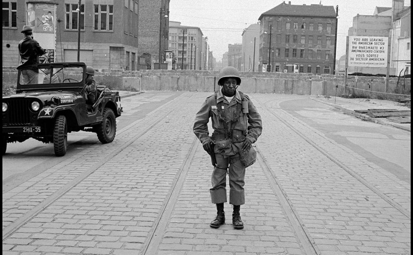An American soldier standing guard at the Berlin Wall