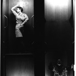 """Lindy Annis Still from """"Paternoster Trilogy (Part II), 1991  Performative Installation for 17 Figures and a Circulating Elevator Photographs by Holger Schnaars  Collection of the Artist"""