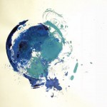 A vibrant swirl spattering of blue and green paints on paper.